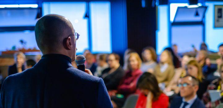 Male presenter speaks to audiences